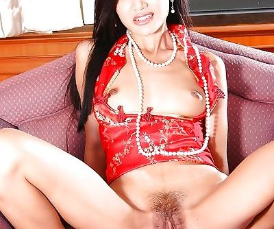 Awesome brunette stretches her lovely tight unshaved pussy in close-up