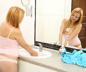 Cute young girl Rebecca J toys her horny pussy on bathroom vanity
