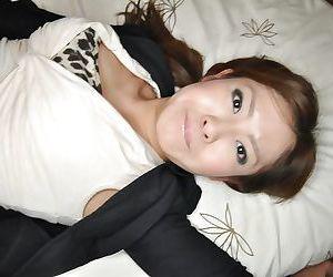 Asian babe Hitomi Aoshima masturbates her teen pussy with toys
