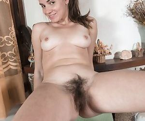 Young brunette Natalia flaunts both her hairy pussy and her sexy bare feet