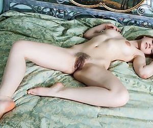 Sweet young Mariam bends over to display her hairy beaver and tight little ass