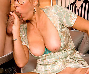 Mature tutor Erica Lauren seduces a young boy wearing glasses