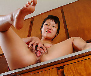 Short haired Asian housewife Vicky showing off furry underarms