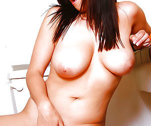 Big busted brunette toying her gash and licking her puffy nipples