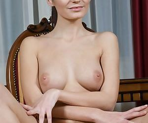 Sexy young Leila strips naked to expose her hairy pussy and spread wide