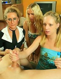 Slutty mature lady in glasses sharing a big cock with her lusty teen friends