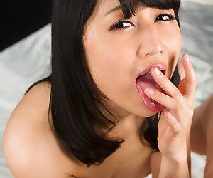 Sexy Japanese filial gives a handjob and eats cum get a bang distance off resulting girl