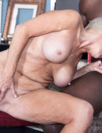 Short haired aged lady Lexy Cougar eats cum from a glass after interracial sex