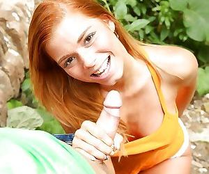 Busty redheaded Euro teen Chrissy Fox giving handjob and bj in forest