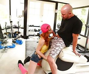 Redheaded teen chick in pink socks earns extra cash by swallowing cum