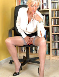 Blonde businesswoman Amazing Astrid undressing after work