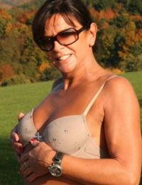 Naughty UK woman Lady Sarah flashing pierced pussy outdoors