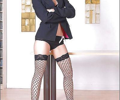 Seductive asian babe in fishnet stockings taking off her skirt