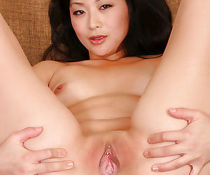 Naughty Asian first timer Lena removes dress and panties for nude pics