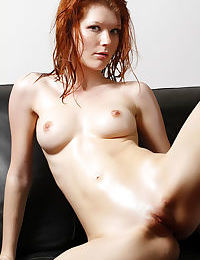 Hot redhead Mia Sollis giving closeup view of shaved pussy in bare feet