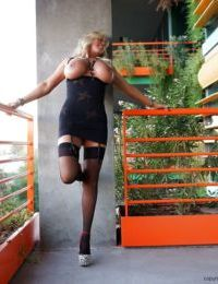 Sensual blonde Sandra Otterson takes off her skirt and poses topless