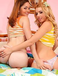 Young girls Jewel & Lexi end pillow fight with kiss and proceed to undress