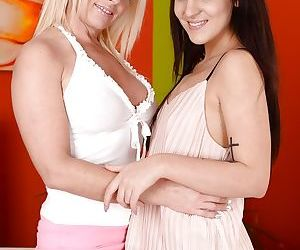 Older and younger lesbians Bella Beretta and Franny humping and kissing