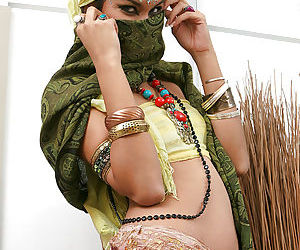 Fully clothed Indian female Yesica uncovering her forbidden face