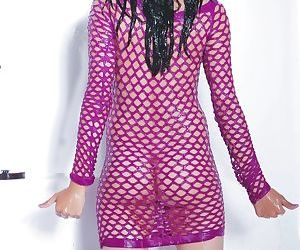 Sexy Indian chick removes her mesh dress as the shower soaks her