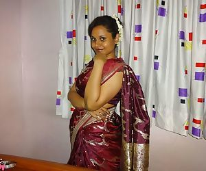 Clothed Indian woman strips to her black bra and underskirt