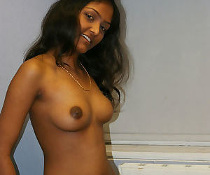Desi solo girl holds her nice tits as she undresses to model in the nude