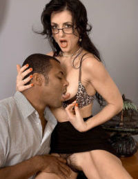 Super hot mature Lake Russell wears glasses to give a big black cock blowjob