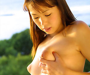 Big titty Asian babe Hikari strips off lingerie while outdoors