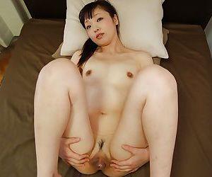 Shy asian MILF Tomomi Sone undressing and expposing her honey pot