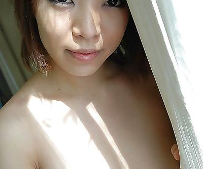 Naughty asian chick Asami Noda undressing and spreading her lower lips