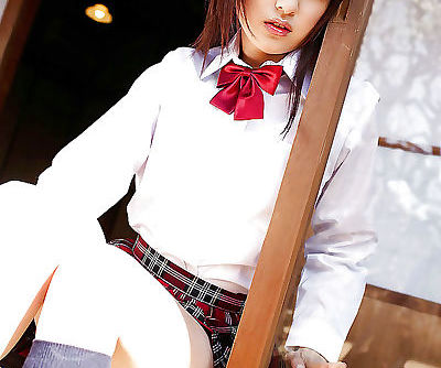 Asian schoolgirl Misa Shinozaki toying her cooter through her panties