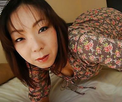 Mature asian slut Yoriko Akiyoshi strips down and enjoys sex toys play