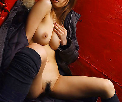 Sultry asian model Sumire poses with her big natural tits exposed