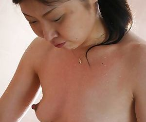 Lusty asian MILF with hard nipples taking shower and ill feeling the brush horde