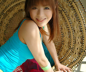 Nasty asian baby doll uncovering her nice jugs and unshaven bosoms