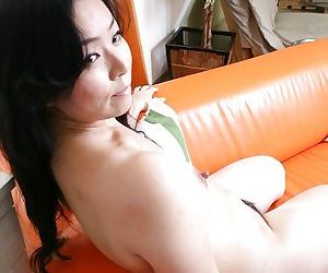 Asian MILF Takako Nishazawa posing naked and demonstrating her gradual twat
