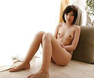 Asian chick Megumi Morishima undressing and spreading her legs