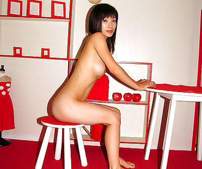Bosomy asian cutie with hairy cooter stripping and spreading her legs