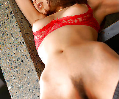 Sexy asian lady in red lingerie and stocking taking off her panties