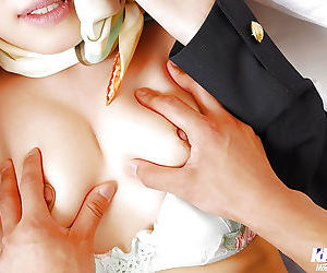 Duteous asian lady in stockings gets undressed with an increment of give fucked