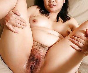 Sassy asian MILF Rumiko Shiga gets naked coupled with has some pussy toying joke