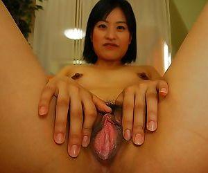 Rollicking asian MILF Misuzu Okazaki undressing and spreading the brush pussy lips