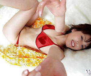 Pretty asian babe Nana Okano posing in red sheer lingerie