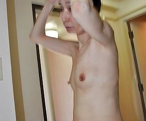 Slippy mature asian lass Nobue Toyoshima gives a blowjob after shower