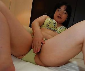 Asian MILF strips less and gets the brush hairy cunt pleased by vibrator