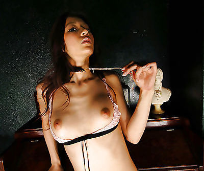 Anari Suzuki taking off her lingerie and spreading her slender legs