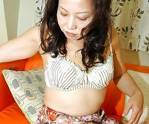 Woman of ill repute asian MILF strips all over and has some pussy vibing fun