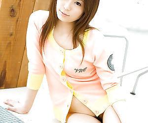 Sweet asian babe Riri Kuribayashi flashing her titties and hairy poon