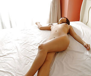 Cute asian babe Maki Hoshino stripping and posing naked on the bed