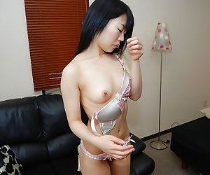 Asian chick in stockings Yuri Ayase slowly uncovering her fuckable curves